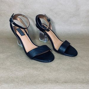 Deena and ozzy Black strap clear heels.